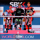 Rez a toast: Jonathan Rea celebrates another victory, flanked by Marco Melandri (left) and Chaz Davies