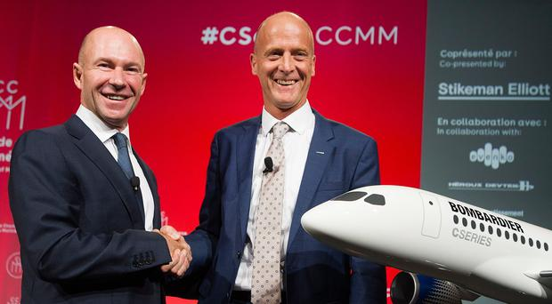 Bombardier president and chief executive Alain Bellemare (left), shakes hands with Airbus boss Tom Enders during a business meeting in Montreal