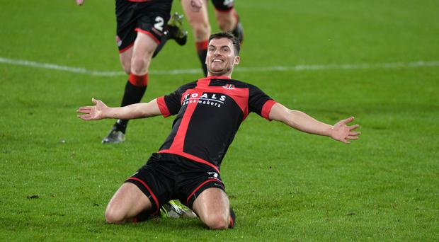 Crusaders Philip Lowry scores during this evenings game at Windsor Park in Belfast. Photo Colm Lenaghan/Pacemaker Press