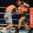 On fire: Ryan Burnett slams home a right hand during his victory over Zhanat Zhakiyanov