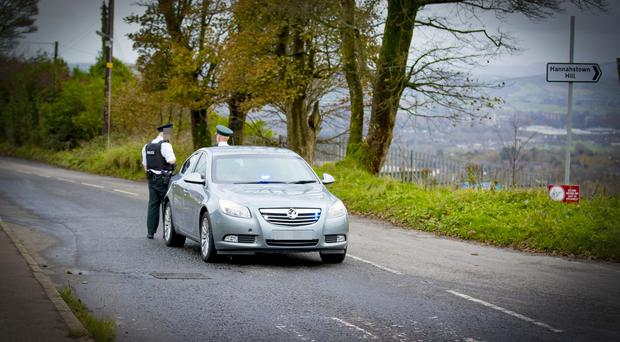 Police officers at the scene of an ongoing incident on the Upper Springfield in west Belfast following reports of a suspicious object in the area on October 24th 2017 (Photo by Kevin Scott / Belfast Telegraph)