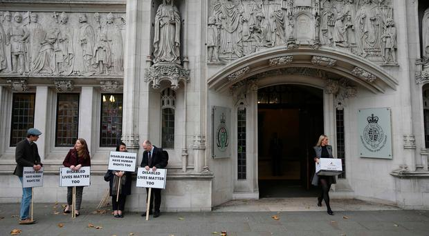 Anti-abortion activists demonstrate outside the the Supreme Court in central London on October 24, 2017 where a case on the abortion regime in Northern Ireland is being heard. Pic: Getty