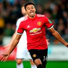 Two good: Jesse Lingard wheels away following his second goal after earlier putting United ahead