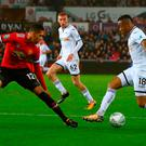 Close watch: Chris Smalling keeps an eye on Jordan Ayew