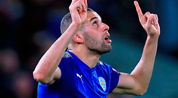 Looking up: Islam Slimani after netting for Leicester