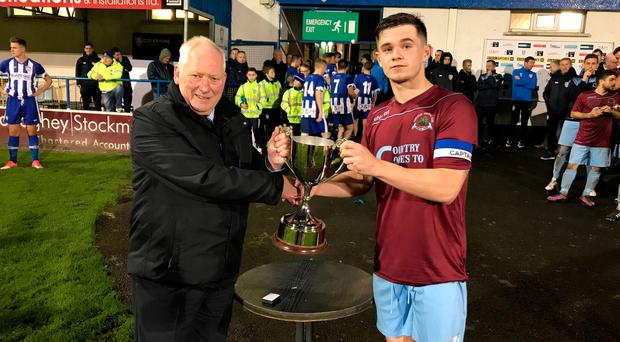 Winners: Institute captain Michael McCrudden receives the North West Cup from Billy Smallwoods