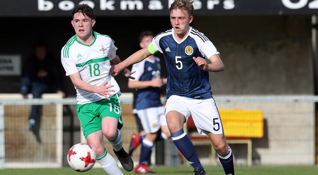 Northern Ireland's winning goal-scorer Peter McKiernan up against Scotland captain Ben Cameron at Seaview