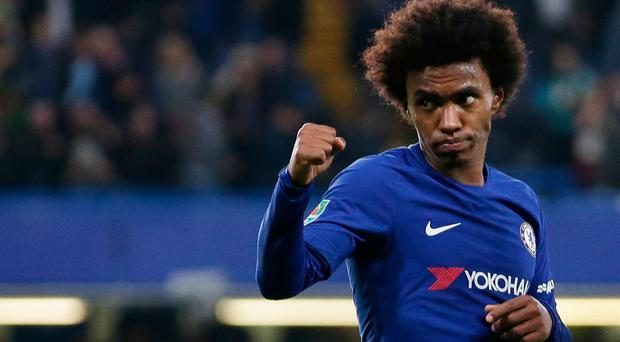 Chelsea's Brazilian midfielder Willian celebrates after scoring their second goal during the English League Cup fourth round football match between Chelsea and Everton. Pic Getty