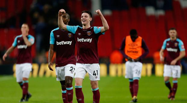 West Ham United's Italian defender Angelo Ogbonna (L) and West Ham United's Irish defender Declan Rice celebrate after the English Premier League football match between Tottenham Hotspur and West Ham United at Wembley Stadium. Pic Getty.