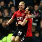 Kil joy: Chris Burke (left) celebrates his late equaliser