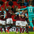Hammer time: Angelo Ogbonna (second left) is mobbed after scoring the winner for West Ham at Wembley