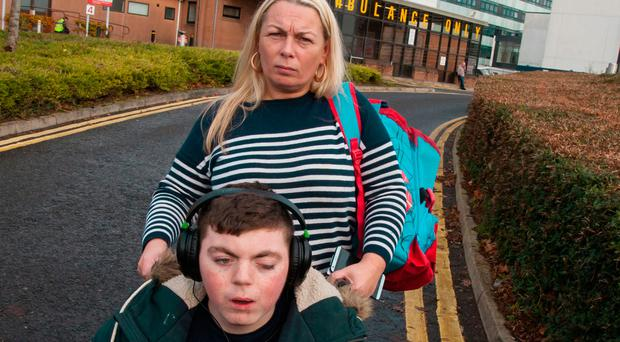 Mother of five Rosie Barrett arriving at A&E, Altnagelvin Hospital, Derry, yesterday with her son Tyrone