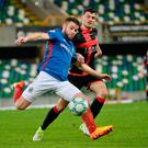 Familiar foe: Linfield midfielder Stephen Lowry takes on his brother, Crusaders ace Philip, at Windsor Park