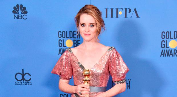 Claire Foy with her Golden Globe award for her performance in The Crown