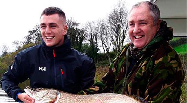 Whopper: Lurgan's Colin Malone (right) and son Dale show off their winning 22lb 6oz pike