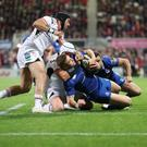 Leinster's Jordan Larmour is tackled short of the line by Rory Best