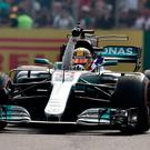 Different class: Lewis Hamilton celebrates his fourth World title in Mexico