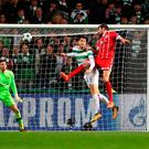 Head boy: Javi Martinez leaps highest to hit the winner for Bayern Munich at Parkhead