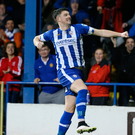 Flying high: Coleraine's Joe McCready celebrates scoring his side's second goal