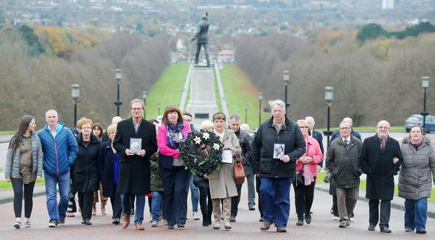 Silent Walk for the Disappeared. 11th annual Silent Walk for the Disappeared takes place at Stormont. Members of the Families of the Disappeared walked from Carson's Statue to the steps of Parliament Buildings where they laid a black wreath with three white lilies representing those who have yet to be found, Joe Lynskey, Columba McVeigh and Robert Nairac. Picture by Jonathan Porter/Presseye.com