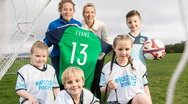 Helping hand: Greenisland FC youngsters Daisy Savage, Luke Quinn, Zara McQuillan and Jacob Richmond join Clare McAllister of Electric Ireland and Northern Ireland's Marissa Callaghan