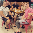 Drink it in: Chris Henry with Ulster team-mates in South Africa
