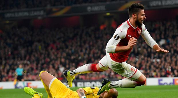 High hopes: Arsenal's Olivier Giroud loses out to Red Star's Milan Borjan at the Emirates last night