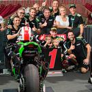 Team effort: Jonathan Rea celebrates with his family and team after World Superbike victory in Qatar last night