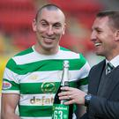Celtic's Scott Brown and manager Brendan Rodgers celebrate breaking the record for the longest unbeaten run in domestic competition by a British top-flight team. Pic: Jeff Holmes/PA Wire.