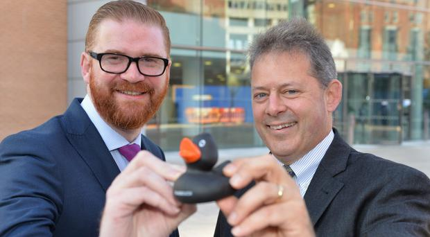 Former economy minister Simon Hamilton with Lou Shipley, president and chief executive officer of Black Duck Software, after firm set up in Belfast
