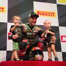 Top of the pops: Jonathan Rea on Qatar podium with sons Jake (4) and Tyler (2)