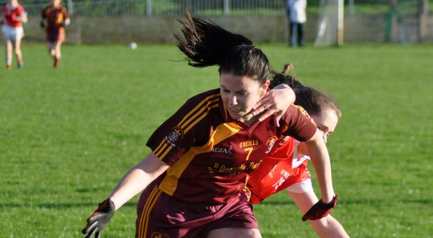 Tough game: Lynda Donnelly of St Macartan's with Lauren Garland