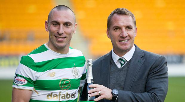 Celtic manager Brendan Rodgers with his captain Scott Brown
