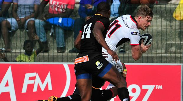 Breaking free: Ulster's Andrew Trimble with Oliver Zono and Michael Makase of the Southern Kings