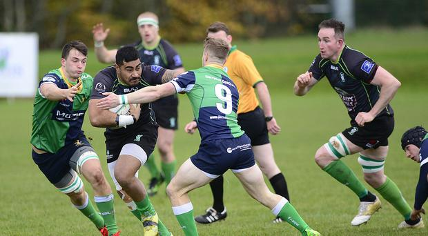 Bursting through: Ballynahinch's Aaron Cairns with Paulie Tolofua of Nass
