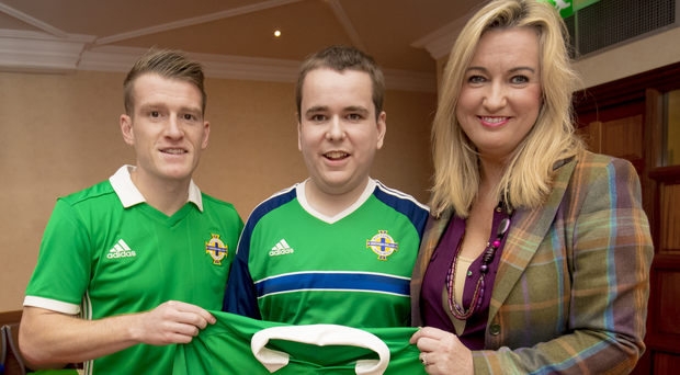 Northern Ireland captain Steven Davis with Jo-Anne and Mark Dobson at the Culloden Hotel