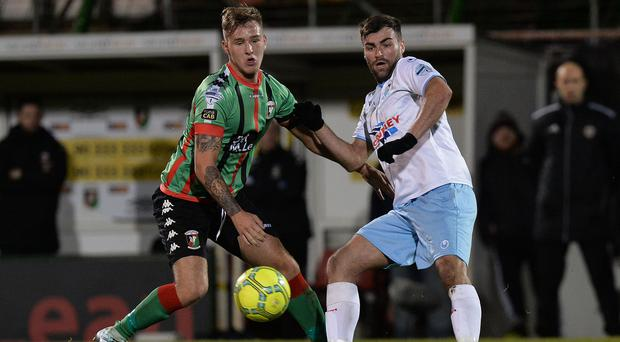 Eyes on the ball: Tre Sterling closes in on Ballymena striker Johnny McMurray