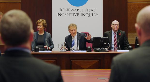 Public inquiry Renewable Heat Incentive scheme begins. Left to right. Statutory Inquiry Panel Member Dame Una O'Brien, Chairman Sir Patrick Coghlin and Technical Assessor to the Inquiry Dr Keith MacLean take their seats as the inquiry begins. Photo by Jonathan Porter / Press Eye.