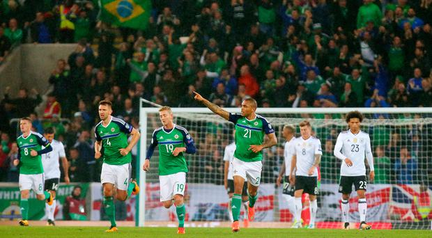On target: Josh Magennis celebrates netting against Germany at Windsor Park last month