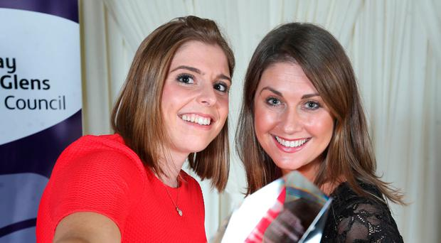 Toast of the Coast: Irish hockey captain Katie Mullan (left) with host Sarah Travers after being named international player of the year at Causeway Coast and Glens Borough Council's annual Sports Awards