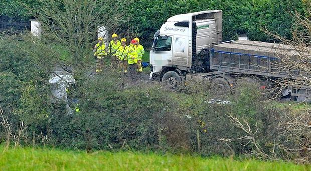 Investigators and Fire Service crew at the scene of the fatal two vehicle crash on the Roguery Road near Toomebridge.