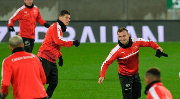 Feeling good: Xherdan Shaqiri training at Windsor Park last night with his Switzerland team-mates