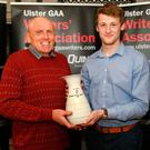Top man: Slaughtneil's Brendan Rogers receives his Ulster GAA Writers Association trophy from club chairman Sean McGuigan