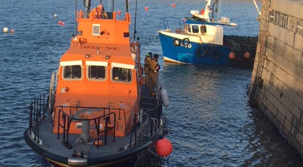 Donaghadee all-weather lifeboat Saxon towing rescued fishing vessel / Credit: Ross Bennett, Donaghadee Lifeboat Crew and Margaret Ramm Donaghadee Lifeboat Press Officer