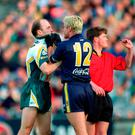 Boiling point: Peter Canavan gets to grips with Jason Akermanis in 2000