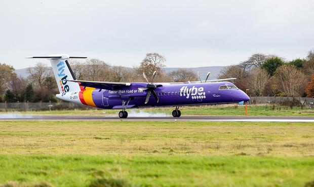 A Flybe aircraft making an emergency landing at Belfast International Airport. Pic Alan Lewis - PhotopressBelfast.co.uk