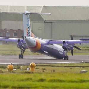 A Flybe aircraft at Belfast International Airport making an emergency landing. Pic Alan Lewis - PhotopressBelfast.co.uk 10/11/201