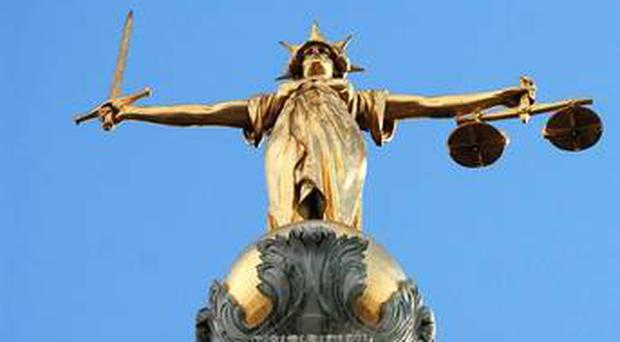 A man accused of assaults on both of his parents choked and slapped his father until his false teeth fell out, the High Court heard yesterday