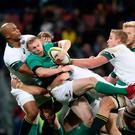 Getting to grips: Ireland's Keith Earls is tackled by Springboks JP Pietersen and Pieter Steph du Toit