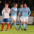 On target: Johnny McMurray celebrates after scoring Ballymena's winner against Linfield last night